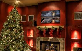 christmas tree next to fireplace walldevil