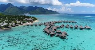 tropical vacation paradise island with overwater bungalows resort