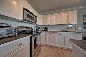 looking for someone to paint my kitchen cabinets should i paint my cabinets renovationfind