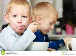 Kids Eating Table Boys Kids Children Eating Corn Flakes Breakfast Meal At The Table