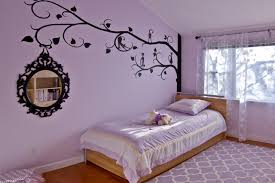 gorgeous black wall decal in the transitional kids purple bedroom