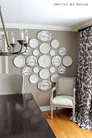How To Arrange Pictures On A Wall by How To Arrange A Photo In Decorative Plates For Wall Home Decor