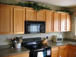 imposing kitchen upper cabinet ideas with wall mounted microwave