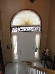 foyer treatment in sheer sunburst arch treatment with decorative