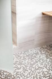 Shower Floor Mosaic Tiles by Photos Hgtv Neutral And Black Mosaic Pebble Shower Floor With