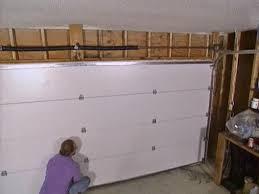 How To Install An Overhead Door Installing A Garage Door How Tos Diy