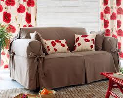 housse canapé et fauteuil housses à nouettes pour fauteuil ou canapé coussins