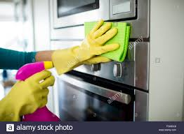 pretty woman doing her house chores stock photo royalty free