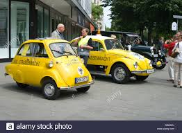 yellow volkswagen beetle royalty free a small vehicle bmw isetta 300 adac and the volkswagen beetle