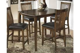 Stuman Counter Height Dining Room Table And Bar Stools Set Of - Dining table for bar stools