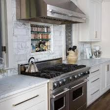 blue kitchen cabinets with carrera marble countertops