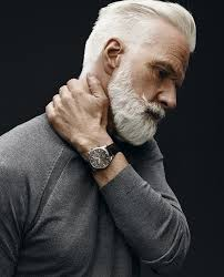 handsome gray haired and bearded male model haircut short