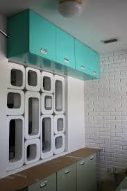 quartz countertops vintage metal kitchen cabinets lighting