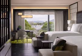 guestroom with a city view at the four seasons kyoto by hba design