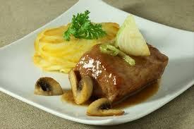 comment cuisiner un filet mignon de porc en cocotte recette de filet mignon de porc braisé aux oignons nouveaux