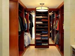 interior small walk in closet designs with lighting good brown color wooden material cool brown color flooring some clothes chandelier circle shaped the