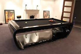 metal billiard table colored black and silver with a hole in the