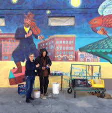 the conservation of chagall returns to venice beach by christina christina schlesinger posing with dougo the original artist that painted the ocean scene vignette on