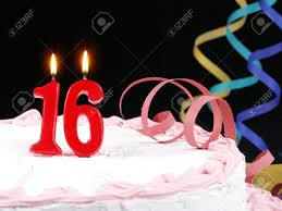 birthday cake with red candles showing nr 16 stock photo picture