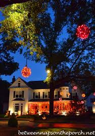 homes decorated for halloween decorating for halloween with exterior lighting garland and lit orbs