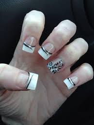 white french tips with silver leopard print and black stripes