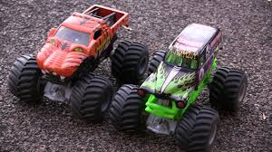 youtube monster trucks jam playing his monster jam trucks grave digger and prowler in the sand