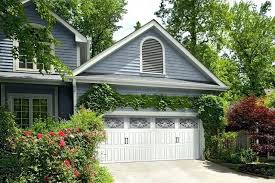 adding the arbor over garage with hardware on doors is easy to do