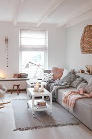 Scandinavian Living Room With Neutral Colors And Pastel Pink - Adding color to neutral living room