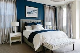blue accent wall eggshell home portfolio sophisticated and dramatic master bedroom