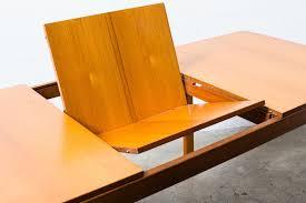 mid century teak dining table with hidden leaf amsterdam modern