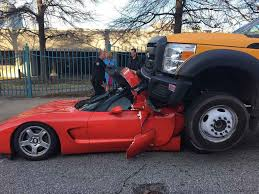 corvette crash ford truck crashes into chevrolet corvette driver survives