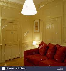 panelled walls a traditional yellow living room with wood panelled walls red