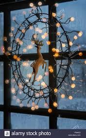 how to hang christmas lights in window christmas lights hanging on window indoors iceland stock photo