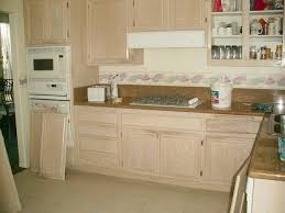White Kitchen Cabinets White Appliances by Before Painting Refinishing Oak Kitchen Cabinet With Glass Door
