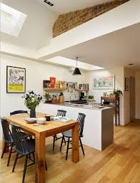 an open kitchen dining room design in a traditional home kitchen