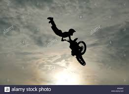 motocross action motocross action backlit mid air stunt london stock photo