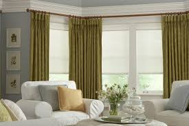 goblet pleat drapes with pleated fabric roller shades window