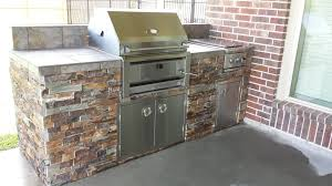 elegant outdoor kitchen with charcoal grill taste