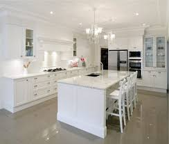 white kitchen island with black granite top custom white kitchen island wall wooden shelf on white wall solid