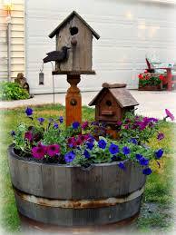 a whiskey barrel planter love the idea of having the bird feeders