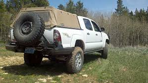 2007 toyota tacoma rear bumper bushmaster 2 0 with swing away tire carrier cbi offroad fab
