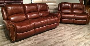 9888 top grain leather nailhead motion sofa love and available