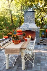 outdoor patio with pavers a large wooden table with chairs and