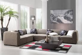contemporary gray sectional couch and dark coffee table decors on