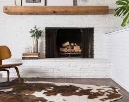 mixing mid century modern and rustic sunroom off center fireplace awesome neutral rustic living room