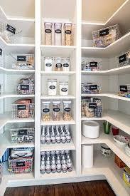 white u shaped kitchen pantry boasts white modular shelves stocked