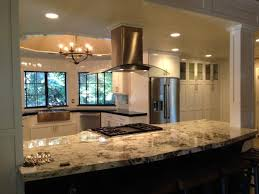 stone countertops kitchen island with columns lighting flooring