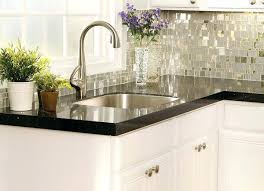 backsplash ideas for white cabinets and black countertops backsplash with white cabinets statement liberty mosaic tile