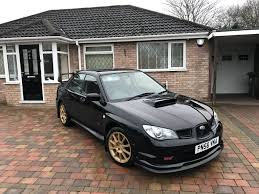 black subaru subaru impreza wrx sti 2 5 2006 hawkeye black in tile cross west