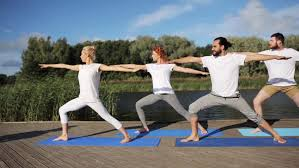 mixed race group of people exercising yoga healthy lifestyle